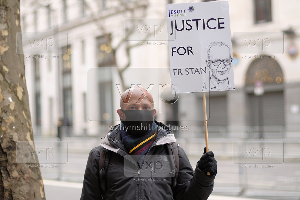 """People from """"Jesuit Mission"""" hold placards outside Indian High Comission in London to protest against arrest of Father Stan Swamy on Thursday, Dec 10, 2020. <br /> The National Investigation Agency (NIA), which deals with anti-terror crimes, arrested him in connection over a 2018 incident of caste-based violence and alleged links with Maoists. The 83-year-old activist and Jesuit priest is now the oldest person to be accused of terrorism in India. (VXP Photo/ Gio Strondl)"""