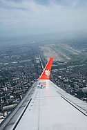 Shortly after take-off, a Lion Air flight from Bangkok to Surat Thani circles over Don Mueang International Airport in Bangkok, Thailand. View from airplane window. (October 10, 2017)