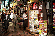 Japanese salarymen in Shinjuku's memory lane, two small alleys filled with barbecue bars.