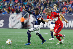 September 22, 2018 - Foxborough, MA, U.S. - FOXBOROUGH, MA - SEPTEMBER 22: New England Revolution midfielder Luis Caicedo (27) fends off Chicago Fire midfielder Bastian Schweinsteiger (31) during a match between the New England Revolution and the Chicago Fire on September 22, 2018, at Gillette Stadium in Foxborough, Massachusetts. The teams played to a 2-2 draw. (Photo by Fred Kfoury III/Icon Sportswire) (Credit Image: © Fred Kfoury Iii/Icon SMI via ZUMA Press)