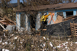 26th Sept, 2005. Cameron, Louisiana. Hurricane Rita aftermath. <br /> Members of the Las Vegas, Nevada Task Force 1, a FEMA search and rescue team scour the destroyed remains of houses and business in Cameron, Louisiana for any signs of life. A rescuer marks the outside of a house with spray paint to indicate no victims.<br /> Photo; ©Charlie Varley/varleypix.com