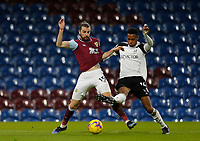Football - 2020 / 2021 Premier League - Burnley vs. Fulham<br /> <br /> Tosin Adarabioyo of Fulham challenges  Jay Rodriguez of Burnley as he breaks into the Fulham area, at Turf Moor.<br /> <br /> <br /> COLORSPORT/ALAN MARTIN