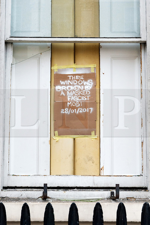 © Licensed to London News Pictures. 30/01/2017. Members of the Autonomous Nation of Anarchist Libertarians (Anal) claim front windows were smashed by a mob after the group took over a £15m London mansion owned by Russian billionaire Andrey Goncharenko.  The grade II listed building in Eaton Square was built in the early 1820's and was is believed to have been empty since Russian oligarch Andrey Goncharenko bought it in 2014.  The group intend to use the property as a homeless shelter and a community centre.  London, UK. Photo credit: Ray Tang/LNP