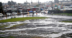 South Africa -Cape Town - 17 August 2020 - Puddles of water near the Nyanga intersection, Cape Town has is experiencing a cold and wet weather because of a cold front this afternoon .Picture:Phando Jikelo/African News Agency(ANA)