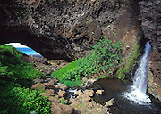 Honopu Arch and waterfall, Napali Coast, Kauai, Hawaii<br />