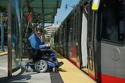 Bruce Oka on the Folsom Station Ramp boarding an LRV in San Francisco