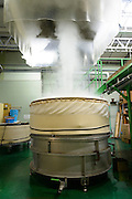 Rice being steamed. Miyashita Sake Brewery, Okayama city, Okayama Prefecture, Japan, January 30, 2014. The city of Bizen in central Japan is famous for Bizen-ware pottery. It is also one of Japan's main traditional sword making regions, home to Osafune sword-makers and polishers.
