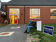 Two President Trump supporters greet voters in a county that is considered solidly Republican. When the polls opened the line was long and voting was steady throughout the day. By the end of the day, voters slowed to a trickle.