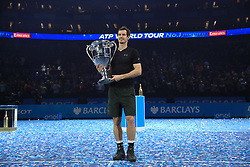Andy Murray poses with the trophy he earnt for finishing the year as world number one during day eight of the Barclays ATP World Tour Finals at The O2, London.