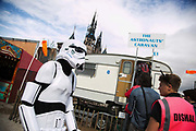 A shallow chested and tired storm trooper walk passed the 'Austronaut's Caravan'. On the first day the show is open only a thousand locals who won free ticket gets an advanced entry to the show.Dismaland, a bemusement park set up by artist Banksy show casing more hand 40 artists. The bemusement park is set in a former lido in Weston Super-Mare.After much secrecy the show opened to a small number of locals from Weston Super-Mare Friday and fully to the public Saturday Aug 22.