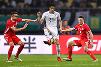 """Edinson Cavani, center, of Uruguay national football team kicks the ball to make a pass against players of Wales national football team in their final match during the 2018 Gree China Cup International Football Championship in Nanning city, south China's Guangxi Zhuang Autonomous Region, 26 March 2018.<br /> <br /> Edinson Cavani's goal in the second half helped Uruguay beat Wales to claim the title of the second edition of China Cup International Football Championship here on Monday (26 March 2018). """"It was a tough match. I'm very satisfied with the result and I think that we can even get better if we didn't suffer from jet lag or injuries. I think the result was very satisfactory,"""" said Uruguay coach Oscar Tabarez. Wales were buoyed by a 6-0 victory over China while Uruguay were fresh from a 2-0 win over the Czech Republic. Uruguay almost took a dream start just 3 minutes into the game as Luis Suarez's shot on Nahitan Nandez cross smacked the upright. Uruguay were dealt a blow on 8 minutes when Jose Gimenez was injured in a challenge and was replaced by Sebastian Coates. Inter Milan's midfielder Matias Vecino of Uruguay also fired at the edge of box from a looped pass but only saw his attempt whistle past the post. Suarez squandered a golden opportunity on 32 minutes when Ashley Williams's wayward backpass sent him clear, but the Barca hitman rattled the woodwork again with goalkeeper Wayne Hennessey well beaten."""