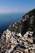 The steep hillside overlooking the sea with the town of Atrani on the Amalfi Coast, Italy.