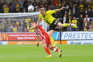 Burton Albion defender Damien McCrory (14) heads away for the Brewers during the EFL Sky Bet League 1 match between Burton Albion and Sunderland at the Pirelli Stadium, Burton upon Trent, England on 15 September 2018.