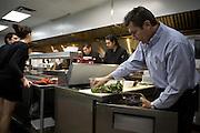 Agaveros Restaurant owner Rafael Garcia preps a salid in the kitchen on Saturday night, Oct. 11, 2009..