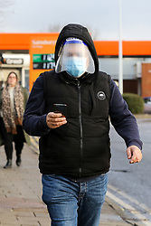 © Licensed to London News Pictures. 06/01/2021. London, UK. A man wearing a protective face mask and a visor in north London. The Met Police have warned that members of public who break coronavirus lockdown restrictions by refusing to wear a mask 'can expect to be fined'.  Prime Minister Boris Johnson announced on Monday 4 January 2021 that England will go into third national lockdown after the mutated variant of the SARS-Cov-2 virus continues to spread around the country, and asked everyone to 'stay at home' and only leave for the specific reasons, until mid-February. Photo credit: Dinendra Haria/LNP