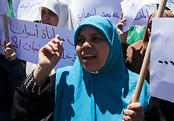 May 24, 2017 - Gaza City, The Gaza Strip, Palestine - A women's march to Hamas in Gaza City against the visit of US President Donald Trump to the Palestinian territories and his statements against the Palestinian resistance. (Credit Image: © Mahmoud Issa/Quds Net News via ZUMA Wire)