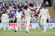 Batsmen Keaton Jennings and Joe Root (left) try to chase off a stubborn pigeon during the first Test Match between England and India at Edgbaston, Birmingham. Photo: Graham Morris  / www.photosport.nz