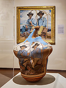 """""""The Twins"""" (a 2017 ceramic work by artist Susan Folwell, born 1970 in Santa Clara Pueblo) feminizes imagery from Ernest Martin Hennings' masculine 1923 painting of the same name, seen in the background. Eiteljorg Museum of American Indians and Western Art, Indianapolis, Indiana, USA"""