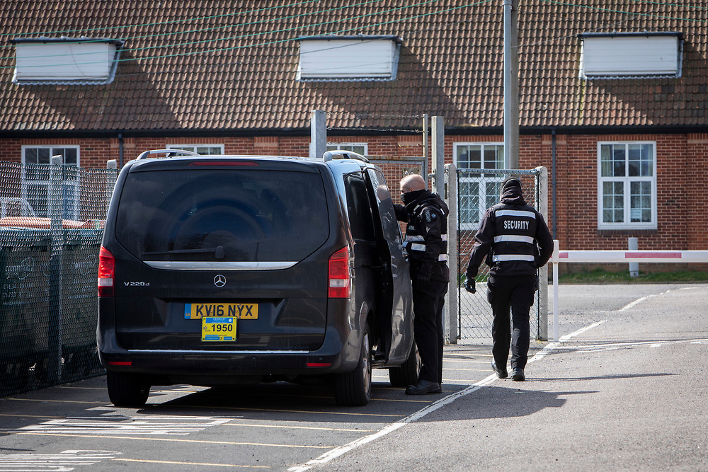 The first taxi arrives of the new intake of asylum seekers arrive at Napier barracks on the 9th of April 2021 in Folkestone, United Kingdom. Despite many criticisms of the site including a damning report from the HM Inspectorate of Prisons declaring the camp filthy and impoverished and Public Health England declaring the accommodation unsuitable durning a pandemic the Home Office continues to place vulnerable people in the former military barracks. (photo by Andrew Aitchison / In pictures via Getty Images)