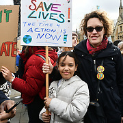 Thousands of student and children on London climate strike in solidarity with #Fridaysforfuture at Parliament Square on 15 March 2019, London, Uk