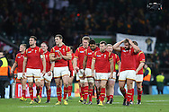 Wales team walk around the pitch dejected after the final whistle to applaud the Wales fans. Rugby World Cup 2015 quarter final match, South Africa v Wales at Twickenham Stadium in London, England  on Saturday 17th October 2015.<br /> pic by  John Patrick Fletcher, Andrew Orchard sports photography.