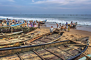activity on the beach when the fishermen are returing from the sea