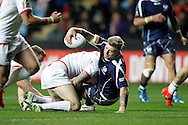 Scotland's Danny Addy (7) is stopped during the Ladbrokes Four Nations match between England and Scotland at the Ricoh Arena, Coventry, England on 5 November 2016. Photo by Craig Galloway.