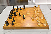 The chess board that Bobby Fischer and Boris Spassky used in their famous 1972 chess match on display at the World Chess Hall of Fame in St. Louis. A new chess history exhibition, US Chess: 80 Years—Promoting the Royal Game in America, opened there with a free opening reception event on March 6, 2019. The chess exhibit will be on display through October 27, 2019. <br /> (Tim Vizer/AP Images for  World Chess Hall of Fame)
