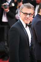 Actor Christoph Waltz winking at the press photographers at the 'Behind The Candelabra' gala screening at the Cannes Film Festival  Tuesday 21 May 2013