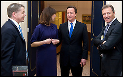 Cabinet Secretary Sir Gus O'Donnell (right) watches the The Prime Minister David Cameron arrive inside the Cabinet room for the first at No10 as the new PM, Tuesday May 11, 2010. with Cabinet Secretary Sir Gus O'Donnell and  Jeremy Heywood (left), currently Permanent Secretary at No. 10..The  Cabinet Secretary Sir Gus O'Donnell steps down at the end of the year and is replaced by Jeremy Heywood (left), currently Permanent Secretary at No. 10, will replace Gus O'Donnell as Cabinet Secretary. Photo By Andrew Parsons/ i-Images