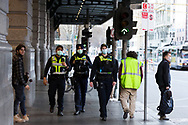 Police are seen patrolling Flinders Street Station during COVID-19 in Melbourne, Australia. Hotel quarantine linked to 99% of Victoria's COVID-19 cases, inquiry told. This comes amid a further 222 new cases being discovered along with 17 deaths. Melbourne continues to reel under Stage 4 restrictions with speculation that it will be extended. (Photo by Dave Hewison/Speed Media)