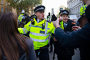 A policeman remonstrates with pro leave protesters outside Downing Street in London, United Kingdom on 31st October 2019. A further extension has been granted until 31st January 2020 and a general election has been called, in a bid to break the Parliamentary deadlock.