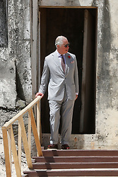 The Prince of Wales, by a door once used by slaves as they were taken to waiting ships, during a visit to Osu Castle, also known as Fort Christiansborg in Accra, Ghana, on day four of his trip to west Africa with the Duchess of Cornwall.