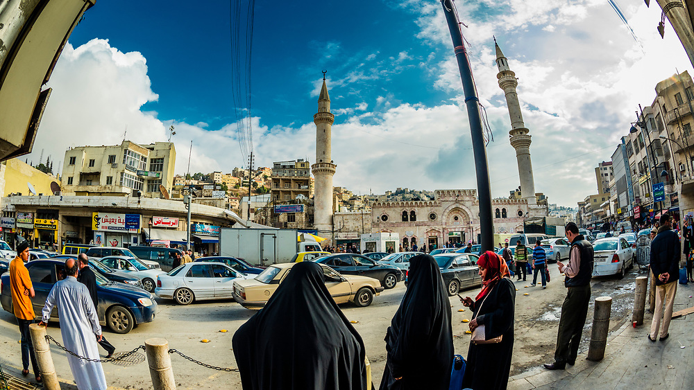Street scene with Grand Husseini Mosque (King Hussein Mosque) in background, Downtown Amman, Jordan.