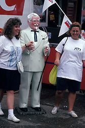 Americana two young women with life size replica of Colonel Sander souther fried chicken franchise restaurant founder Stock photo