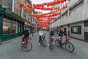 Some people are seen cycling throughout China Town, which is seen deserted in London, Britain, on Sunday, May 3, 2020 - since the country went on lockdown to curb the spread of Coronavirus pandemic outbreak. (Photo/ Vudi Xhymshiti)