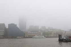 """© Licensed to London News Pictures. 11/05/2016. LONDON, UK.  The """"Walkie Talkie"""" building is shrouded in fog during foggy and wet weather this morning.  Photo credit: Vickie Flores/LNP"""