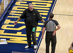 Jan 25, 2021; Morgantown, West Virginia, USA; West Virginia Mountaineers head coach Bob Huggins argues a call during the first half against the Texas Tech Red Raiders at WVU Coliseum. Mandatory Credit: Ben Queen-USA TODAY Sports