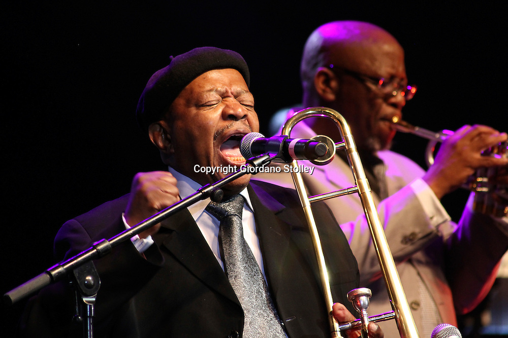 DURBAN - 6 January 2012 - South African jazz legend Jonas Gwangwa performs at the Chief Albert Luthuli International Convention centre in Durban at the closing ceremony for the African National Congress's centenary celebrations. Supporting him, (behind) is an unknown band member. Picture: Allied Picture Press/APP