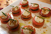 Watermelon taco sandwiches with epazote chili pesto, queso fresco and parsley oil drizzle by Deepak Bellaney, executive chef at Akbar Indian Restaurant.