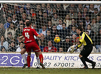 Photo: Chris Ratcliffe.<br />Luton Town v Watford. Coca Cola Championship.<br />02/01/2006.<br />Malkay Mackay (L) forces the ball past Marlon Beresford in the Luton goal.