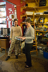 Pictured: Jess Acton, Food Sharing facilitator showed Maggie Chapman some of the up-cycling items available made from tetra-paks<br /> <br /> Scottish Green Party co-convenor Maggie Chapman and local candidate Claire Miller visited the Shrub Swap and Reuse Hub in Edinburgh today as part of the local election campaign. They met Sarah Beattie-Smith, Outreach and communications facilitator, Jess Acton, Food Sharing facilitator and Board Member, Olivia Nathan<br /> Ger Harley | EEm 20April 2017