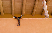 Saddle on adobe wall, Los Luceros guest house, New Mexico<br />
