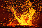 A huge, lava bubble explodes, sending sheets of expanding molten rock airborne. These extremely rare episodes are created when trapped superheated steam violently escapes from beneath the river of lava.