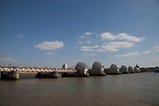 The Thames Barrier, London. This is the flood defences for the capital. On high tides and when water levels are high, the barrier raises to hold back the water level.