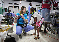 JON M. FLETCHER / The Times-Union -- 021410 -- Crudem Foundation volunteer Joeli Hettler plays her flute for pediatric patients in a makeshift ward setup in a center across the street from Hospital Sacre Coeur in Milot, Haiti, February 14, 2010.  (Jon M. Fletcher, The Florida Times-Union)