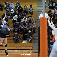 Miyamura's Madison Hyatt (1) goes for a spike in their match against Gallup Thursday night at Gallup High School. The Gallup Bengals had a 22-25, 25-23, 25-22, 25-14 victory over the Miyamura Patriots.