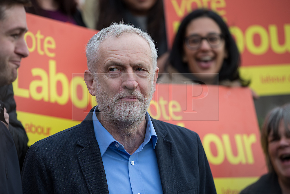 © Licensed to London News Pictures . 04/12/2015 . Oldham , UK . JEREMY CORBYN joins winning candidate JIM MCMAHON (l) on the steps of Chadderton Town Hall in Oldham for a victory rally following Labour's success in the Oldham West and Royton by-election . Photo credit : Joel Goodman/LNP