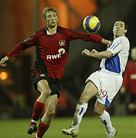 Photo: Aidan Ellis.<br /> Blackburn Rovers v Bayer Leverkusen. UEFA Cup, 2nd Leg. 22/02/2007.<br /> Rovers David Dunn (R) battles with Bayer's Simon Rolfes