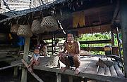 Mentawai indigenous man at house (Indonesia).
